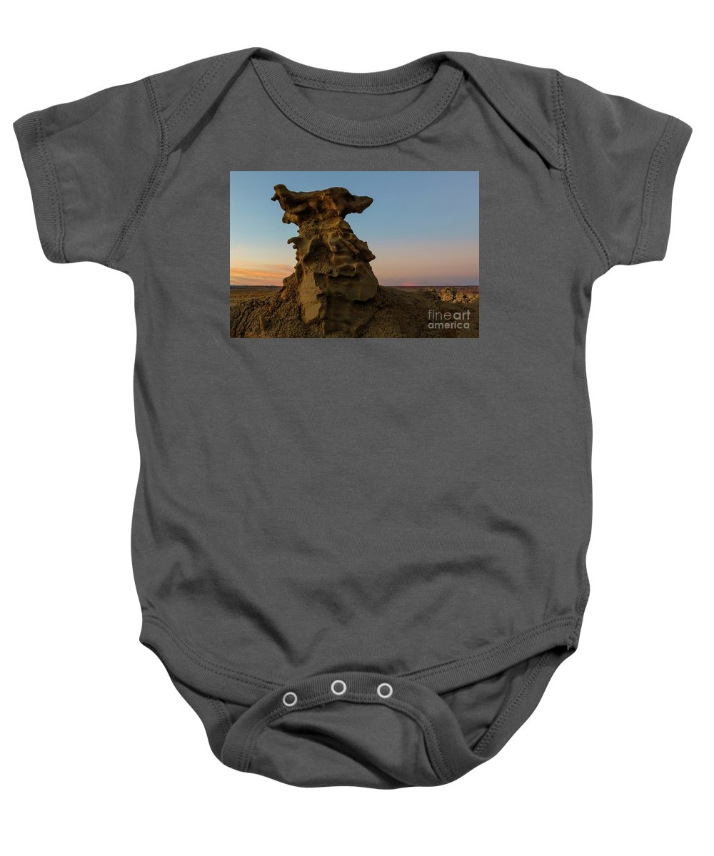 Fantasy Canyon Baby Onesie featuring the photograph Shaped by the Wind by Mike Dawson