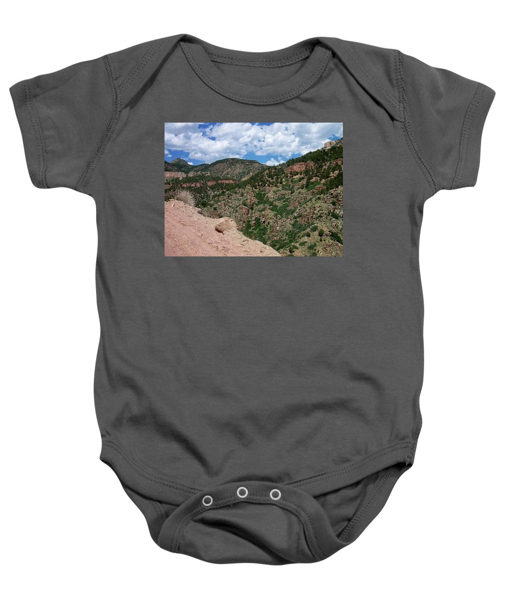 Shelf Road Baby Onesie featuring the photograph Shelf Road Drop Off by Anita Burgermeister