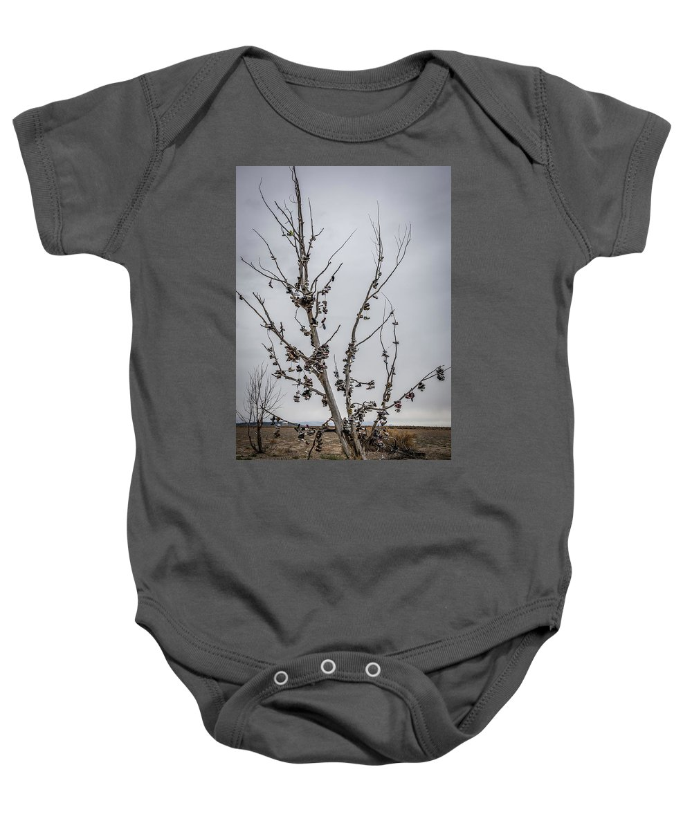 Shoe Tree Baby Onesie featuring the photograph Shoe Tree by Paul Freidlund