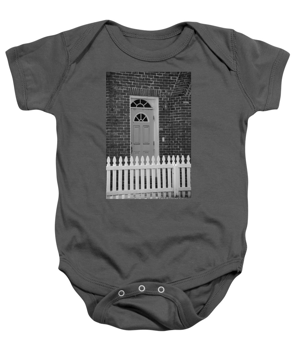 Black And White Baby Onesie featuring the photograph Side Door by Rob Hans