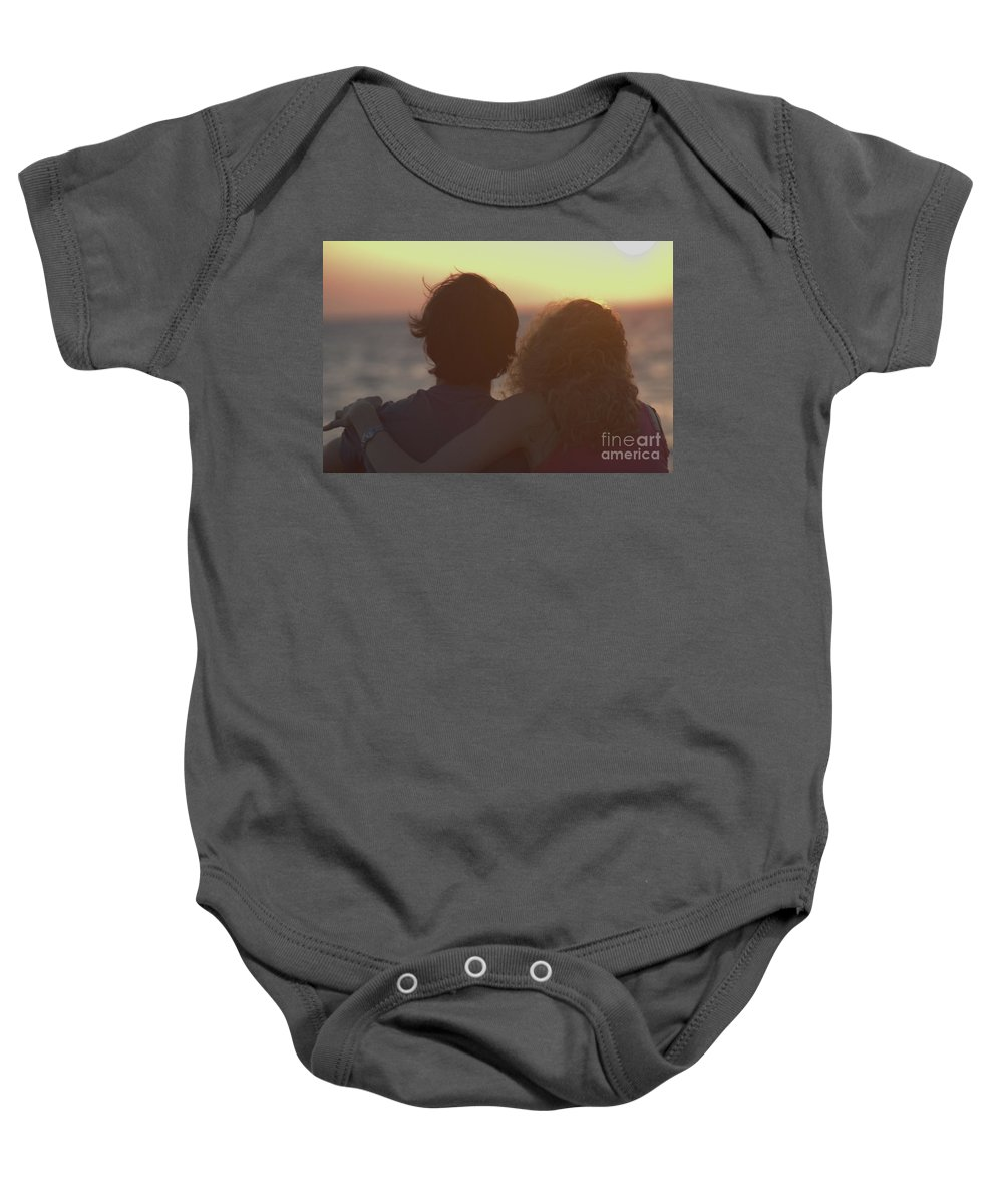 Silhouette Baby Onesie featuring the photograph Silhouette Of A Romantic Couple by Ilan Rosen