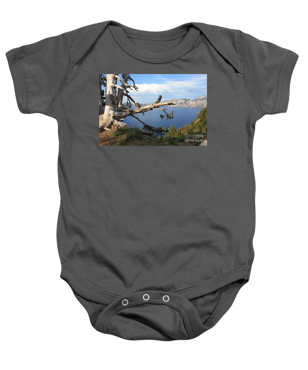 Crater Lake Baby Onesie featuring the photograph Silvery Tree Over Crater Lake by Carol Groenen