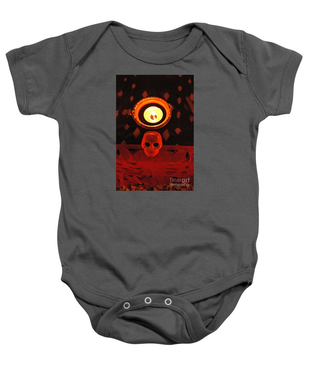 Candle Baby Onesie featuring the photograph Skull And Candle by Jose Luis Montes