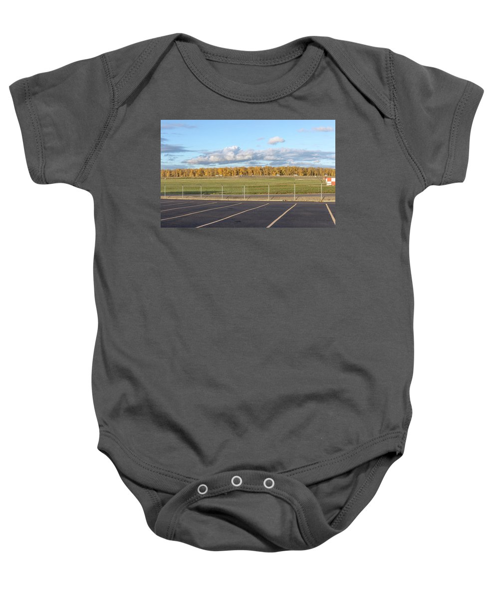 Fences Baby Onesie featuring the photograph Skyview Portland Airport Oregon. by Gino Rigucci