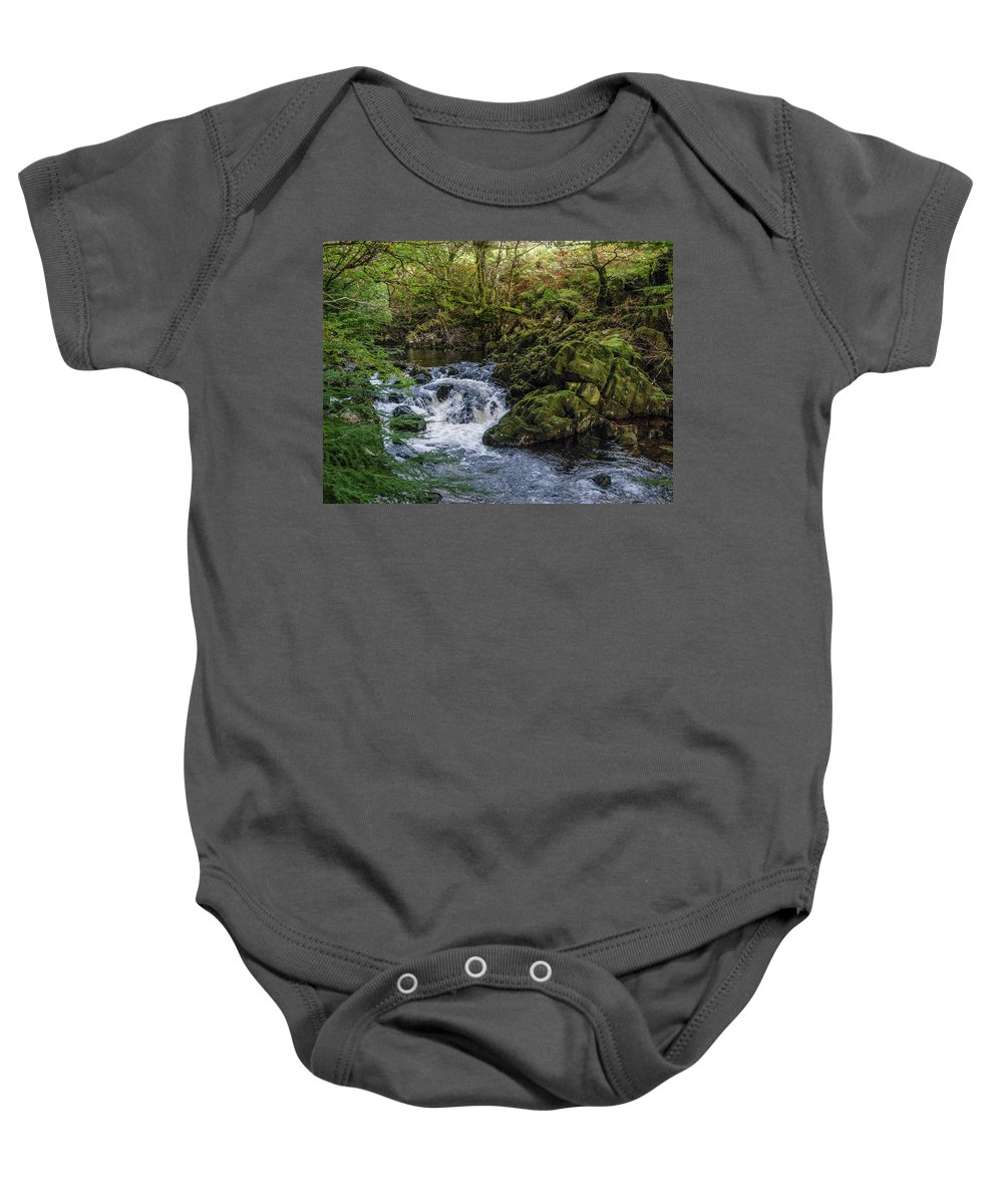 Moss Baby Onesie featuring the photograph Small River Cascade Over Mossy Rocks In Northern Wales by Sallye Wilkinson