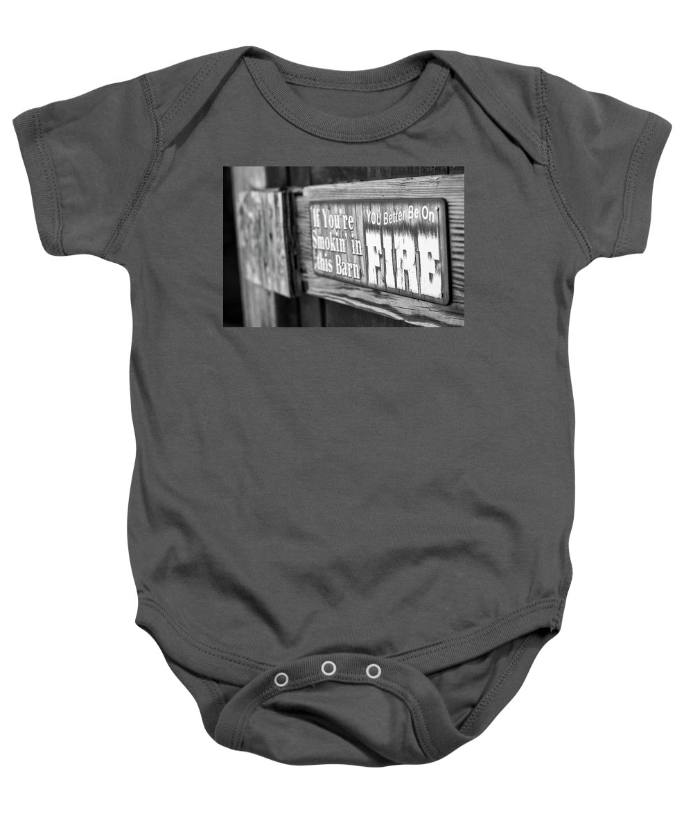 Barn Sign Baby Onesie featuring the photograph Smok'n by Martina Schneeberg-Chrisien