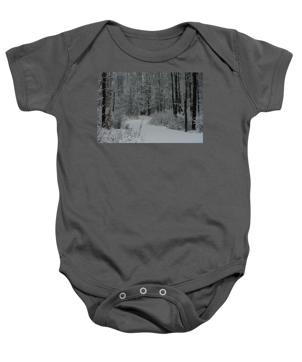Snow Baby Onesie featuring the photograph Snow Covered Path Into The Woods by Alice Markham