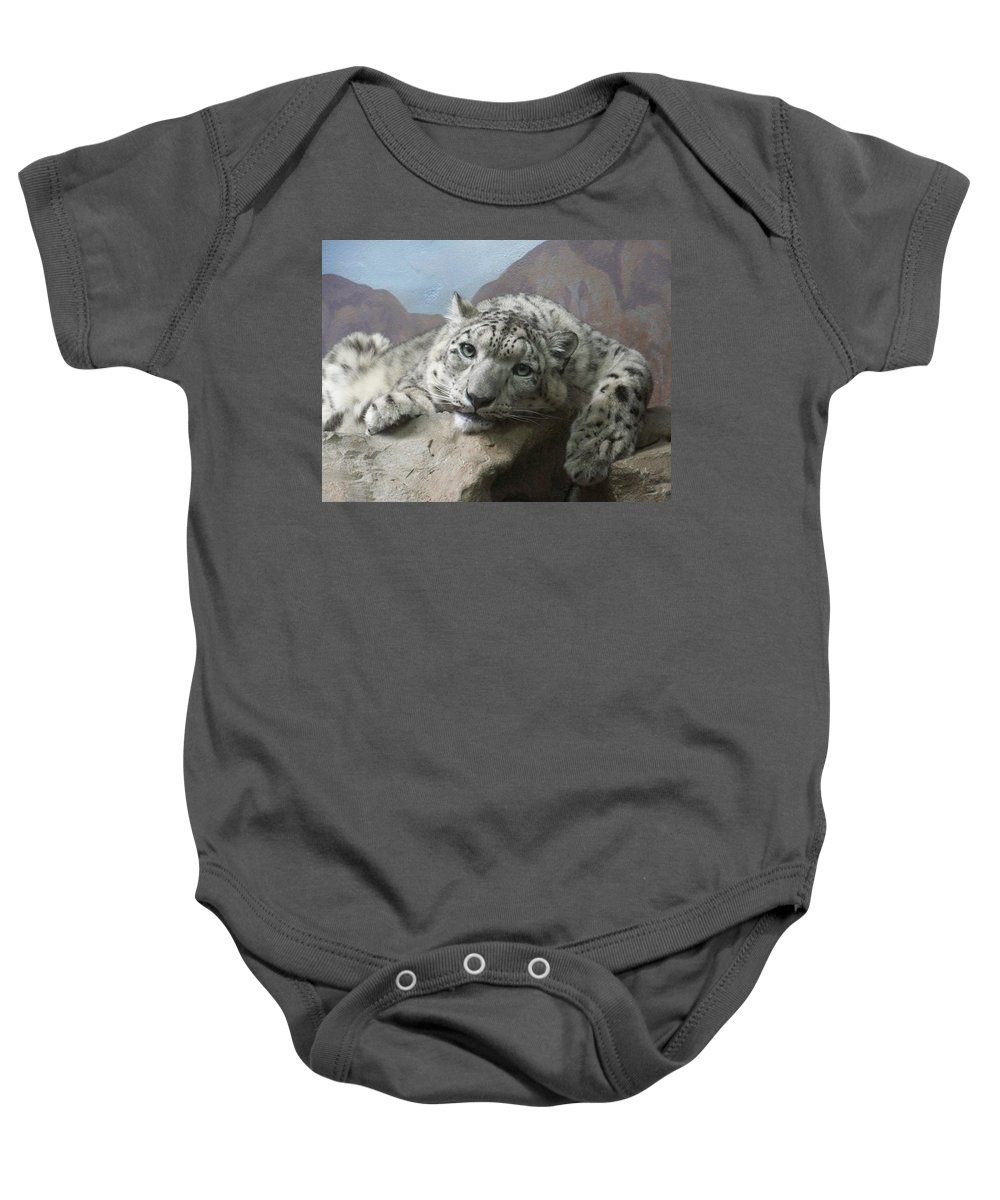 Snow Leopards Baby Onesie featuring the photograph Snow Leopard Relaxing by Ernie Echols