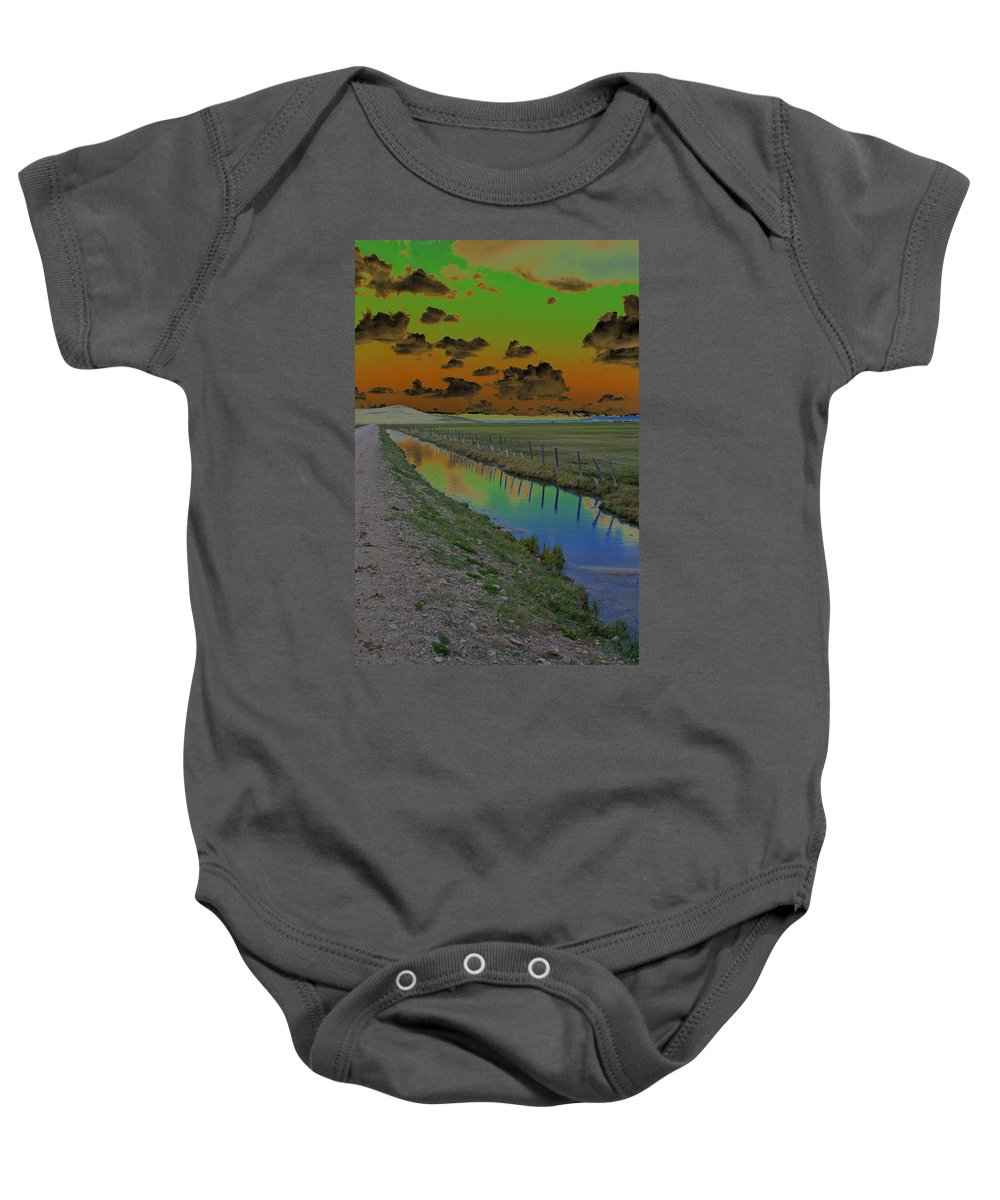 Mountains. Solarized Baby Onesie featuring the photograph Solarized Sky by Heather Coen