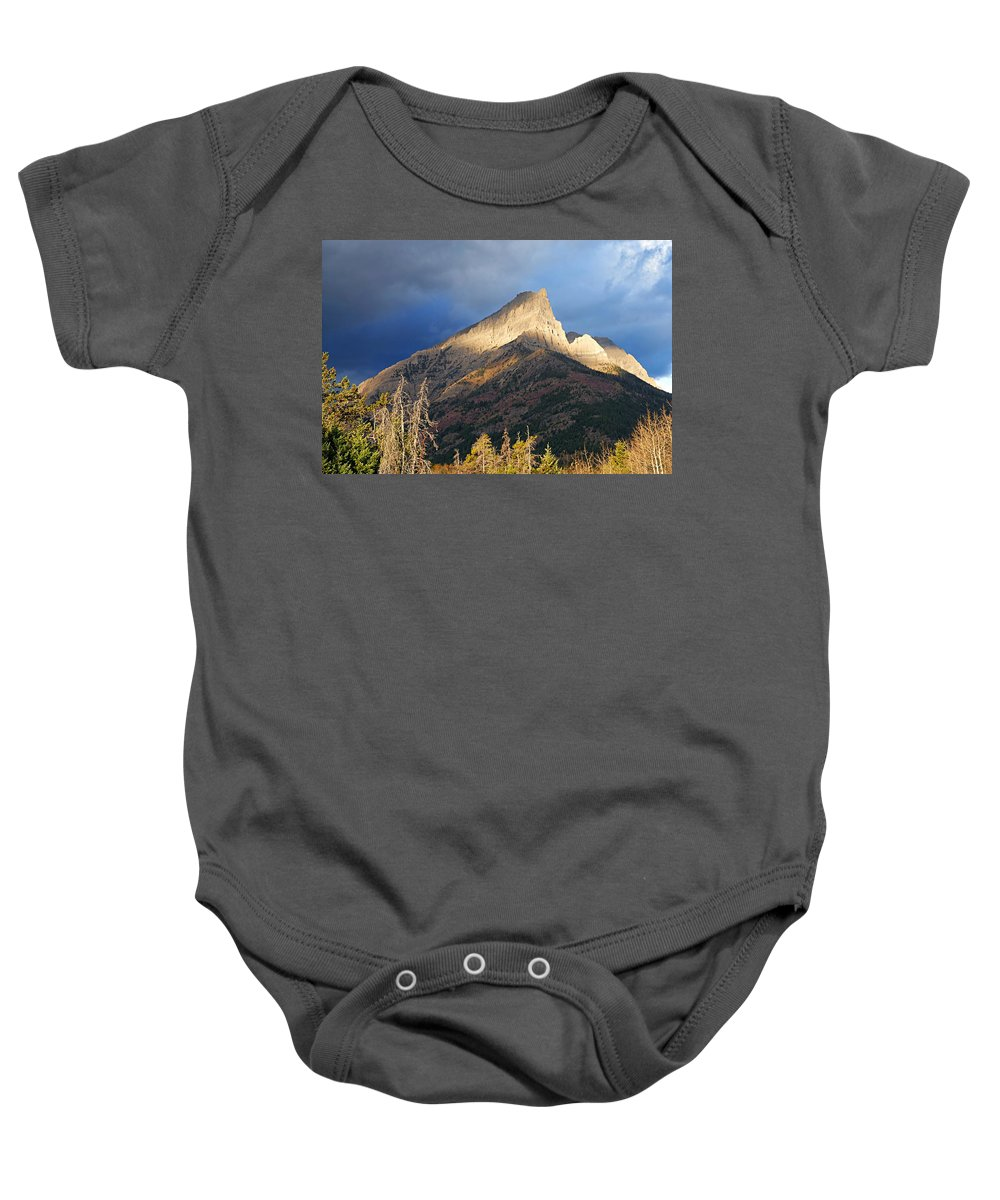 Waterton Lakes National Park Baby Onesie featuring the photograph Spotlit Peak by Larry Ricker