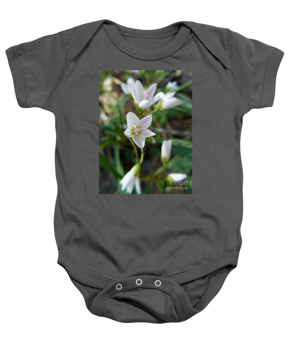 Spring Beauty Baby Onesie featuring the photograph Spring Beauties by Rowena Throckmorton