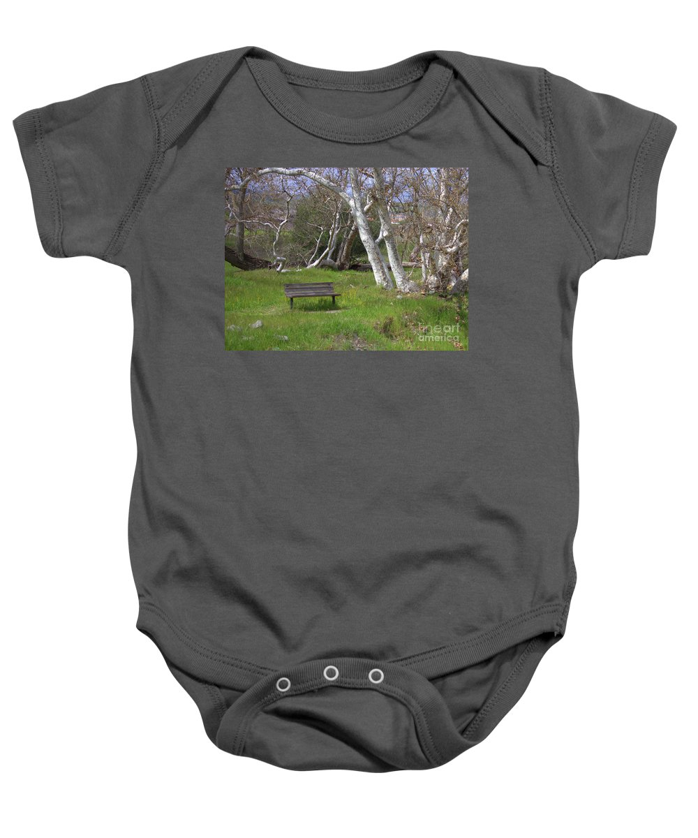 Bench Baby Onesie featuring the photograph Spring Bench In Sycamore Grove Park by Carol Groenen