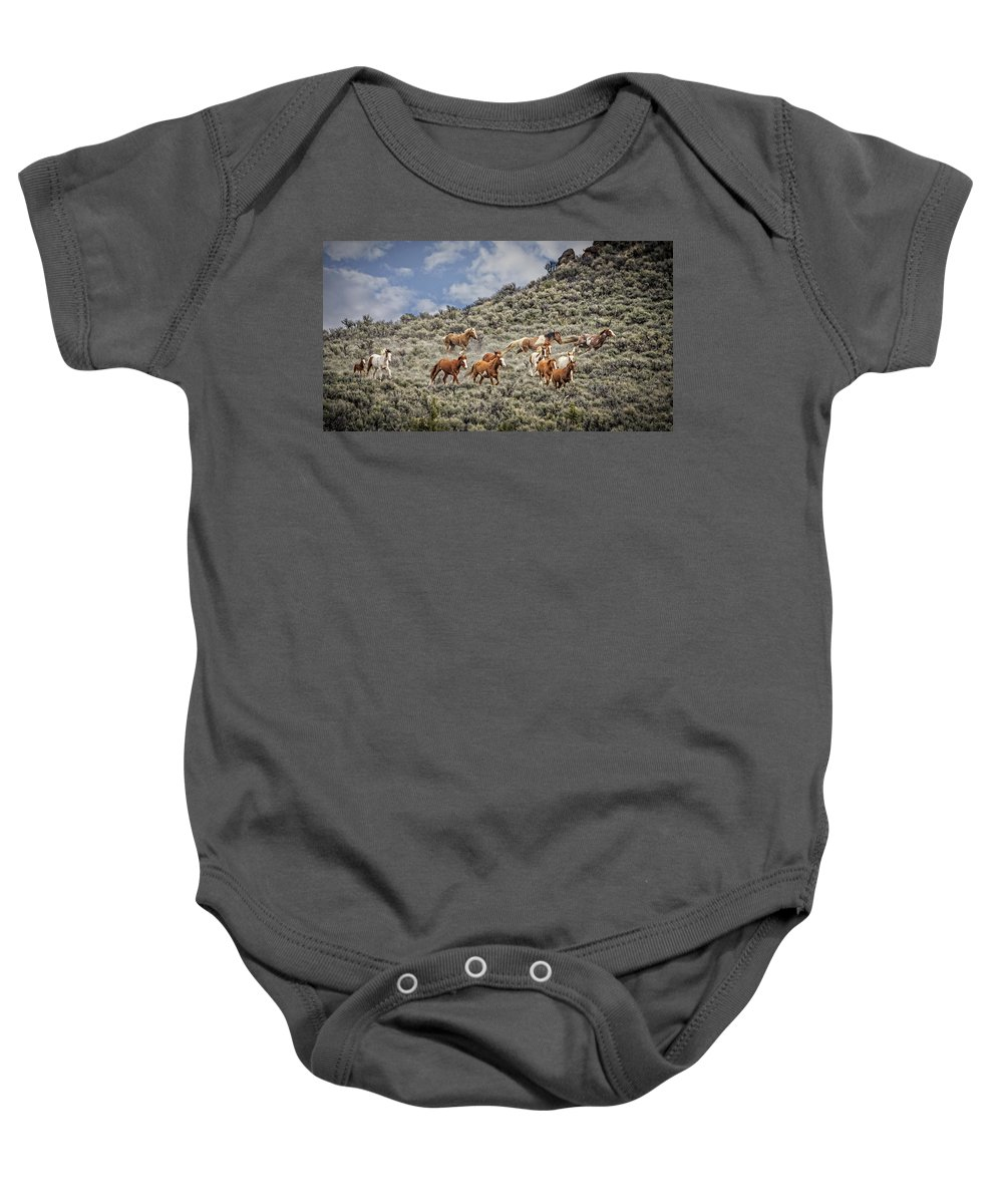 Stampede In The Sage Baby Onesie featuring the photograph Stampede In The Sage by Wes and Dotty Weber