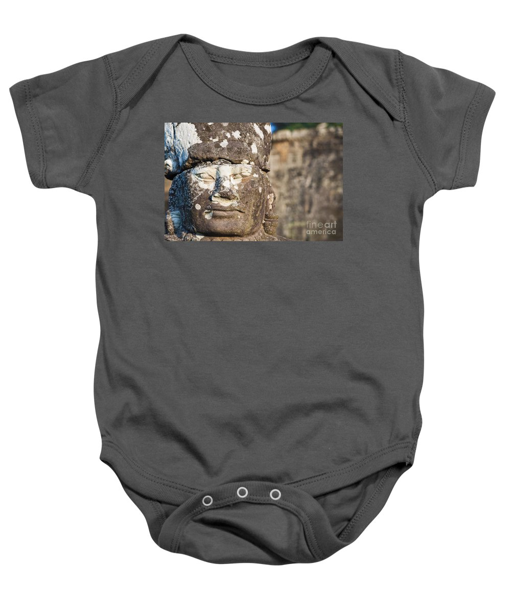 Adorn Baby Onesie featuring the photograph Statue At Angkor Thom by Bill Brennan - Printscapes