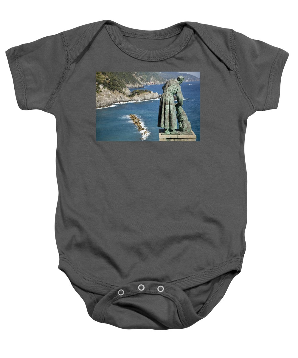 Travel Baby Onesie featuring the photograph Statue Of Saint Francis Of Assisi Petting A Dog by Ian Middleton