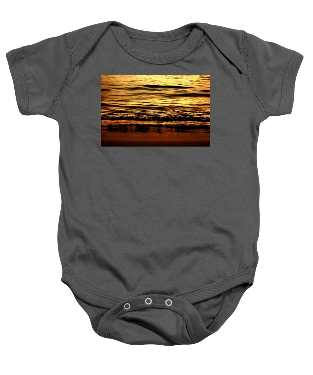 Sea Baby Onesie featuring the pyrography Still Frames In Your Mind by Dana DiPasquale