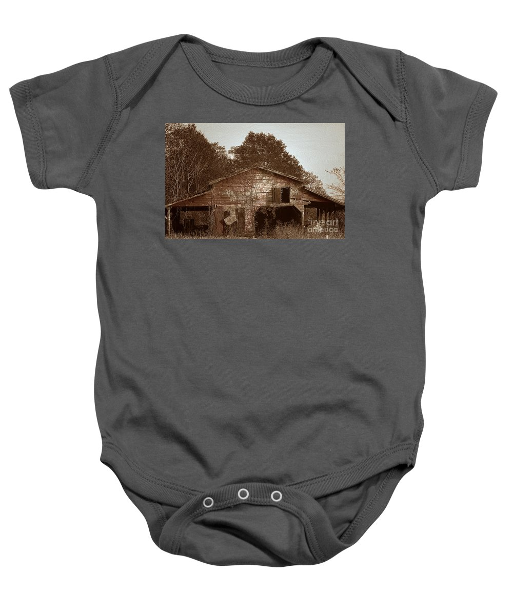 Barn Baby Onesie featuring the photograph Still Working by Amanda Barcon