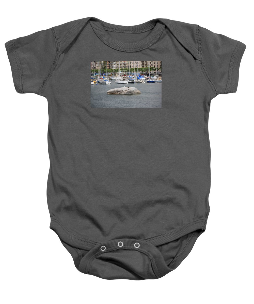 Geneva Baby Onesie featuring the photograph Stone Iron Chain And Seagull by Nurlan Alymbaev
