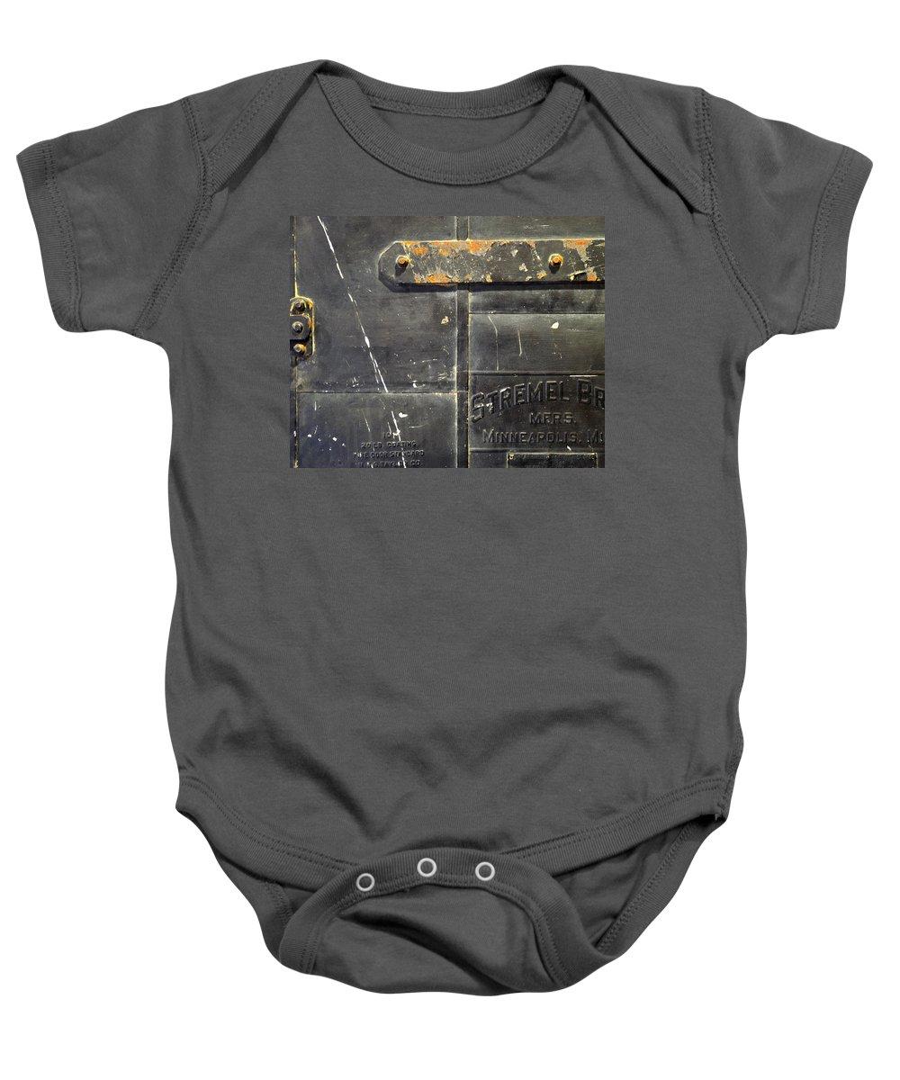 Firedoor Baby Onesie featuring the photograph Stremel Bros. Firedoor by Tim Nyberg