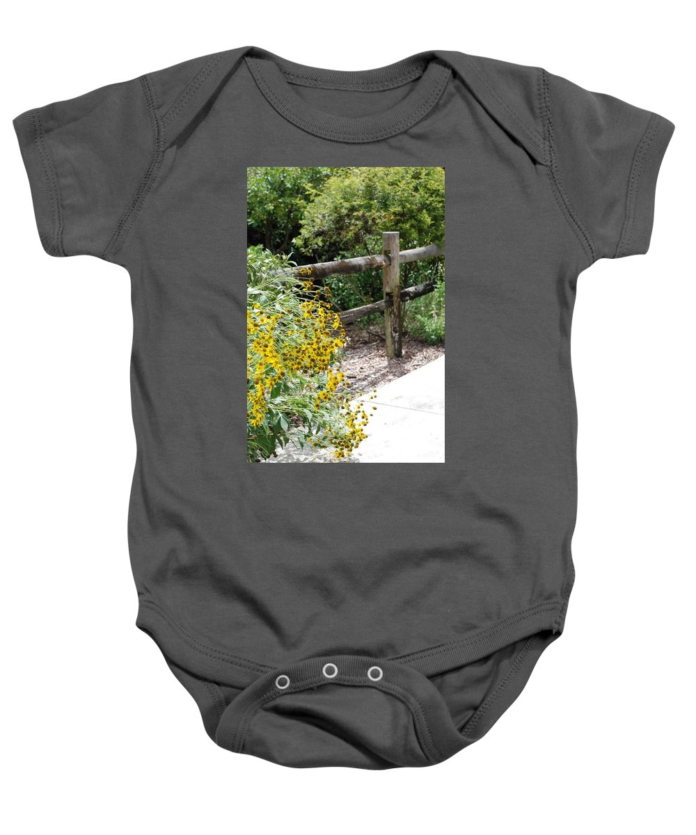 Macro Baby Onesie featuring the photograph Sun Flower Fence by Rob Hans