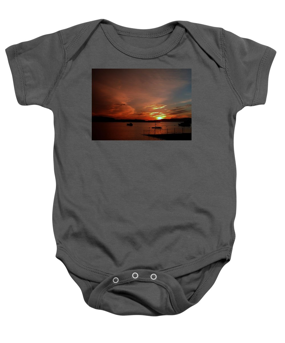 Sunraise Baby Onesie featuring the photograph Sunraise Over Lake by Cliff Norton