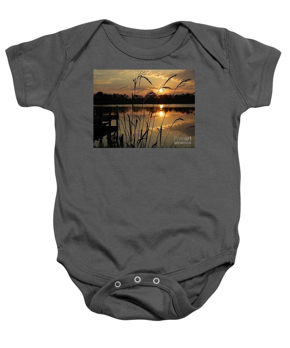 Sunrise Baby Onesie featuring the photograph Sunrise At Grayton Beach by Robert Meanor
