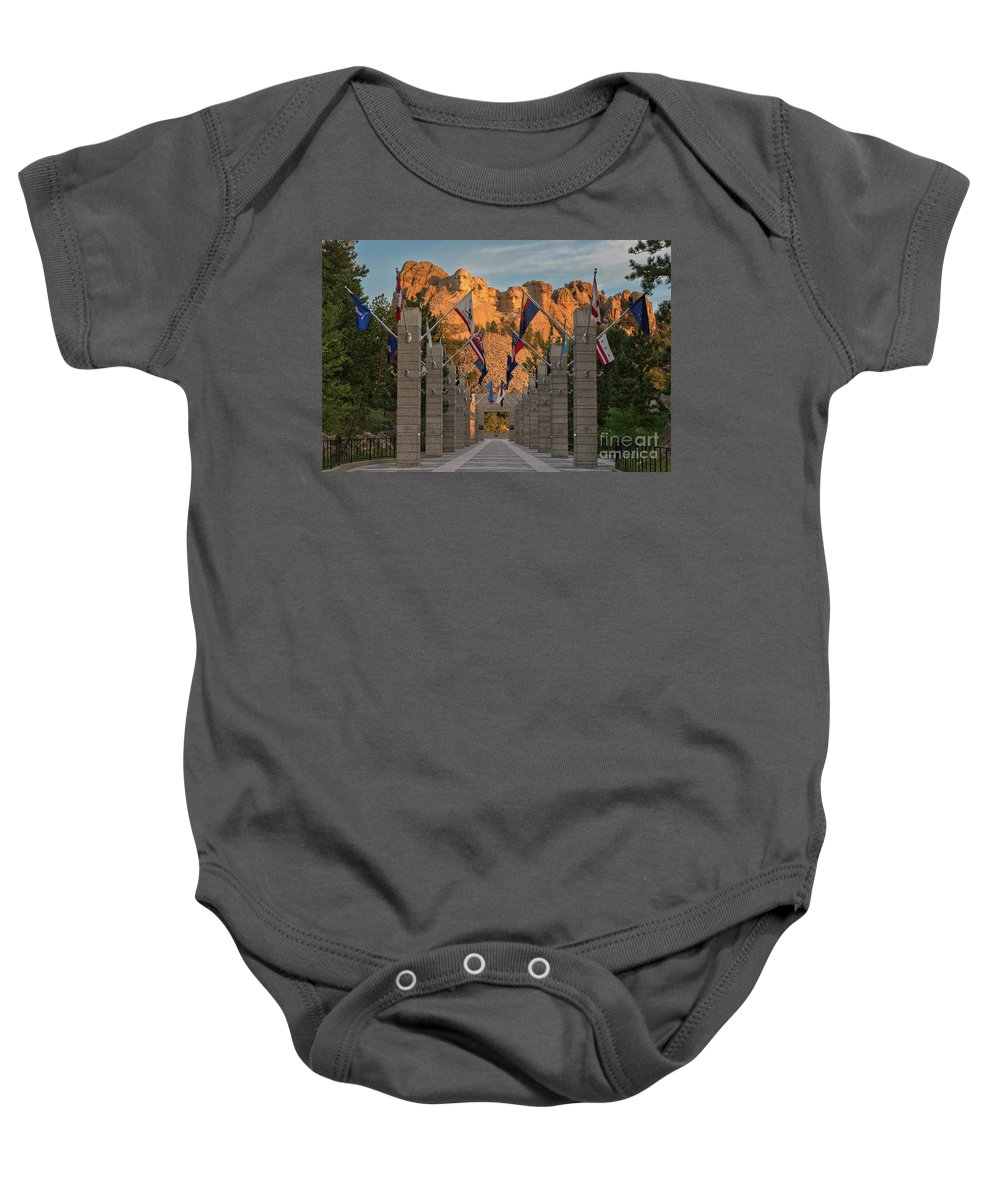 Avenue Of Flags Baby Onesie featuring the photograph Sunrise At Mount Rushmore Promenade by Jerry Fornarotto