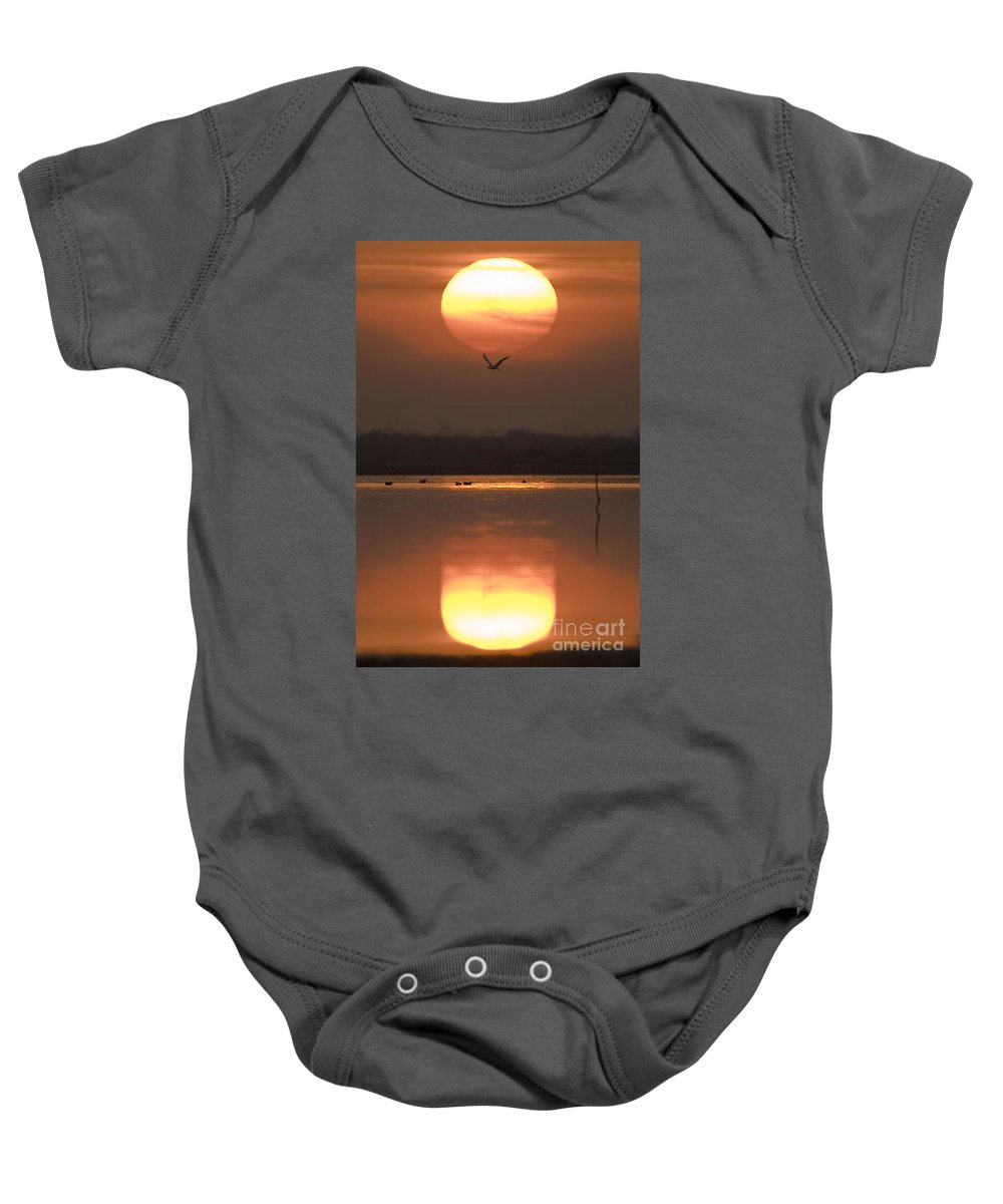 Lake Baby Onesie featuring the photograph Sunrise Reflection by Hitendra SINKAR