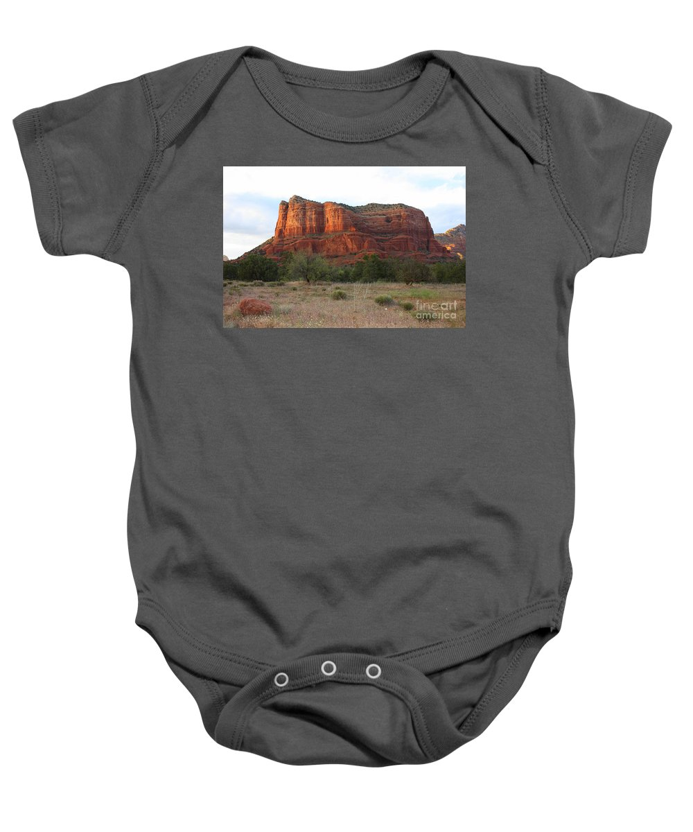 Baby Onesie featuring the photograph Sunshine On Courthouse Butte by Carol Groenen