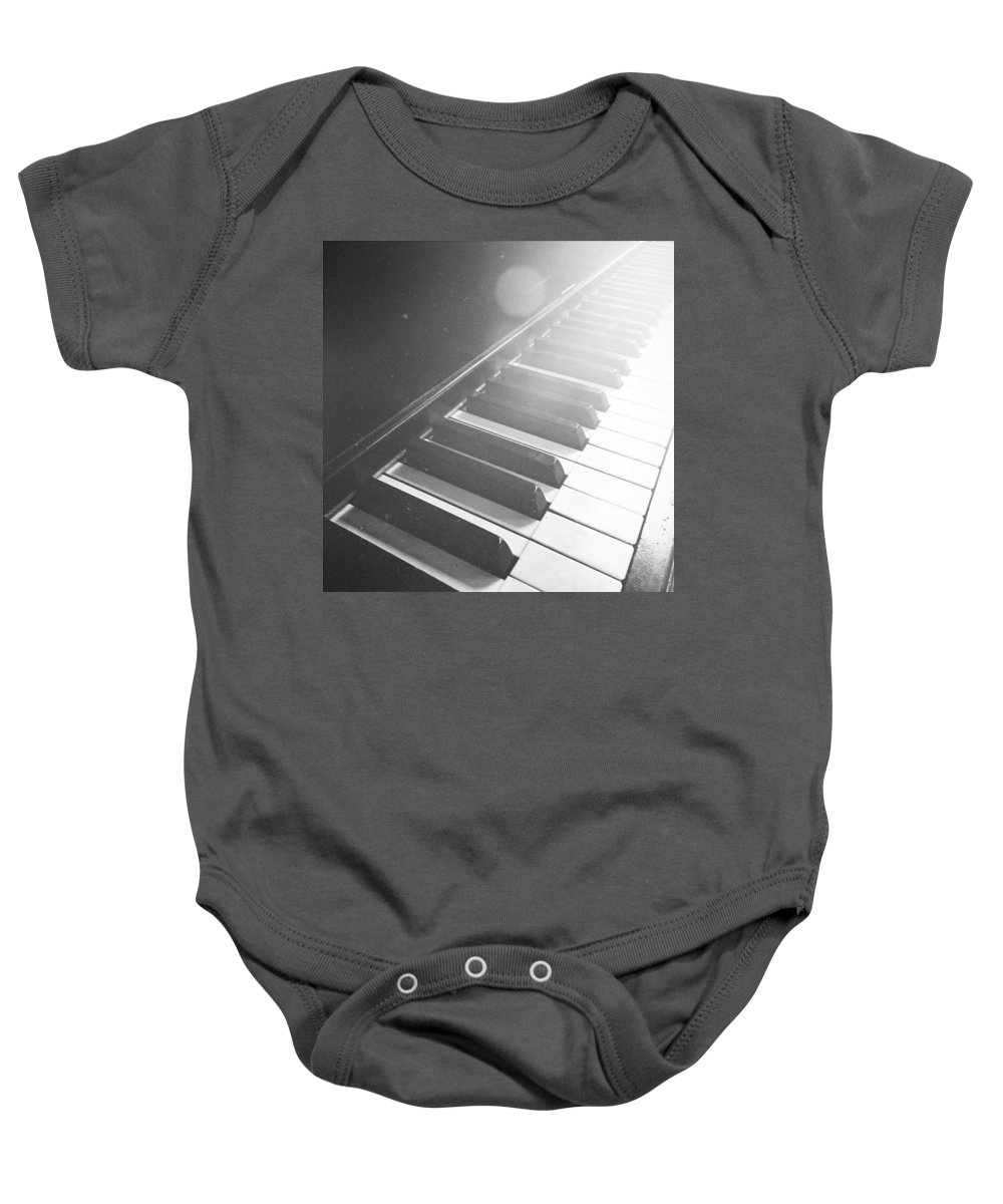 Music Baby Onesie featuring the photograph Swan Song Music Piano Keys Black And White by Andy Gimino