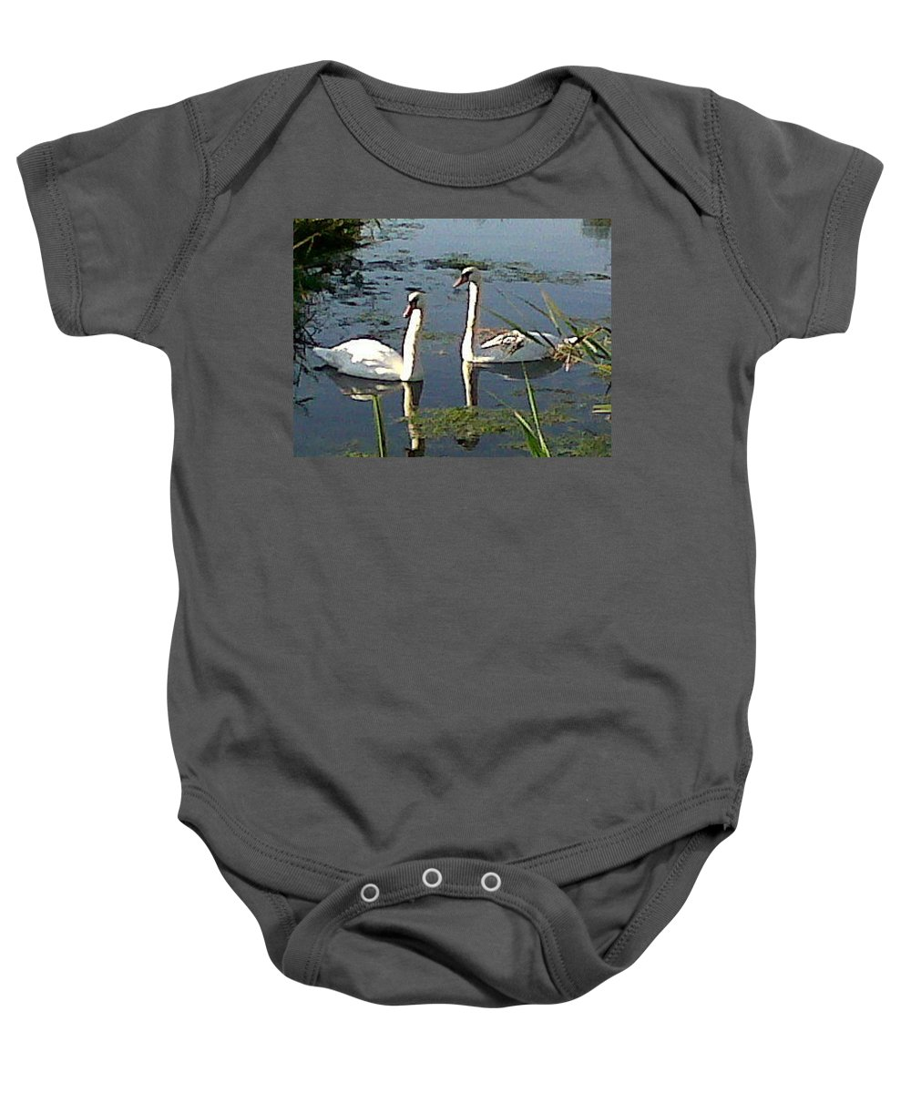 Swans Baby Onesie featuring the photograph Swans In The Sunshine by Susan Baker
