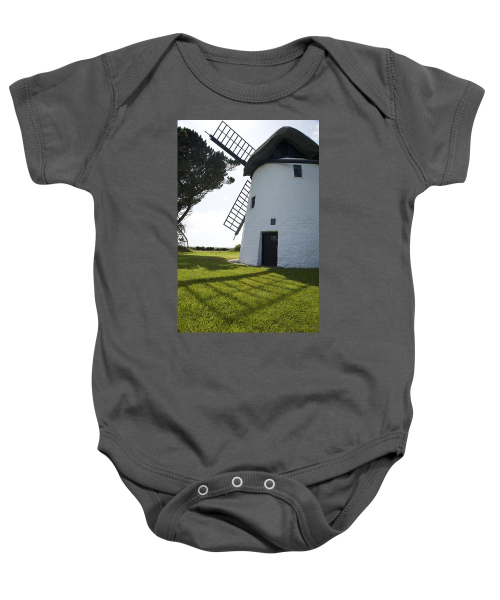 Historic Baby Onesie featuring the photograph Tacumshane Windmill by Ian Middleton