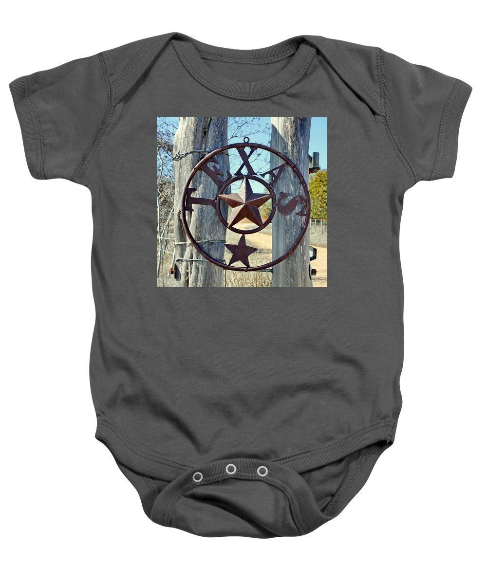 Texas Baby Onesie featuring the photograph Texas Star Rustic Iron Sign by Terry Fleckney