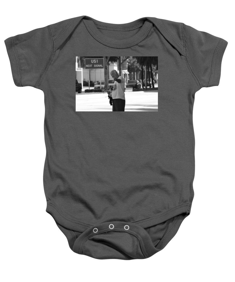 Black And White Baby Onesie featuring the photograph The Devil Man by Rob Hans