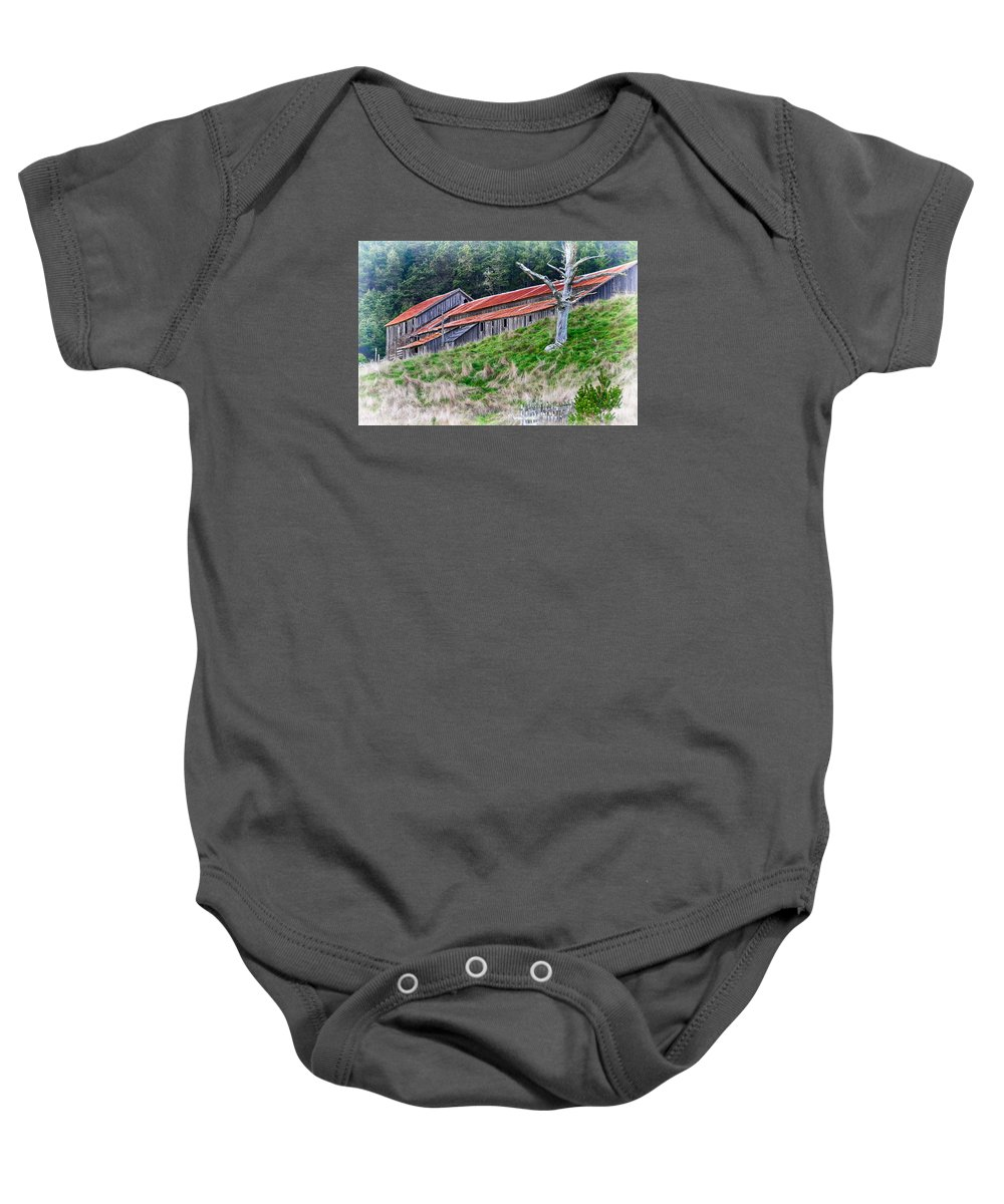 Barn Baby Onesie featuring the pyrography The Forgotten Barn by Robert Ploen