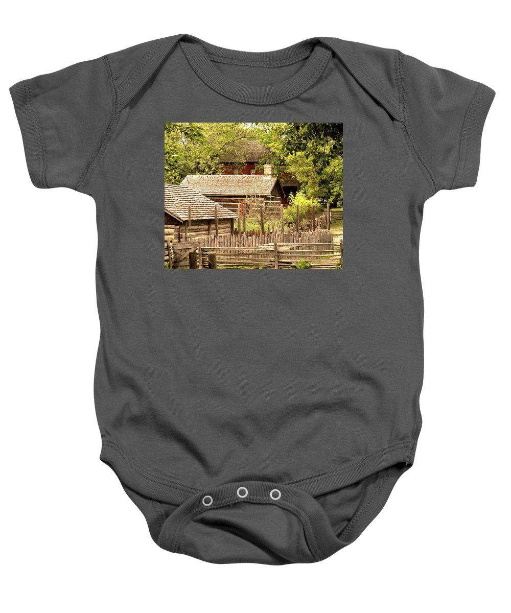 Log Cabins Baby Onesie featuring the photograph The Homestead by Ian MacDonald