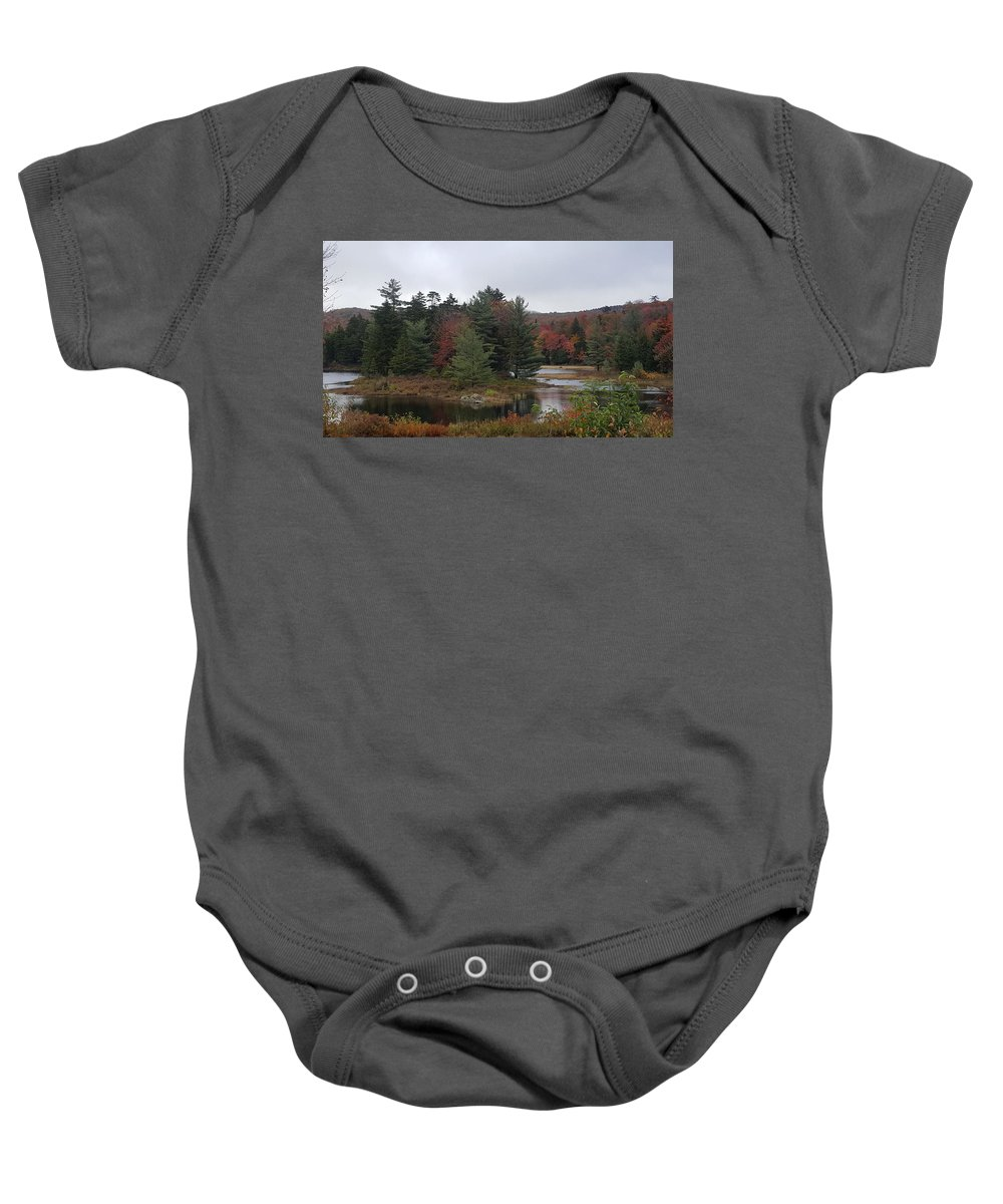 Island Baby Onesie featuring the photograph The Island Of Pines by Kevin Humphrey