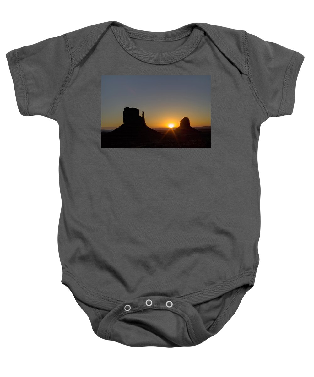 Pictorial Baby Onesie featuring the photograph The Mittens At Sunrise Monument Valley Navaho Tribal Park by Roger Passman