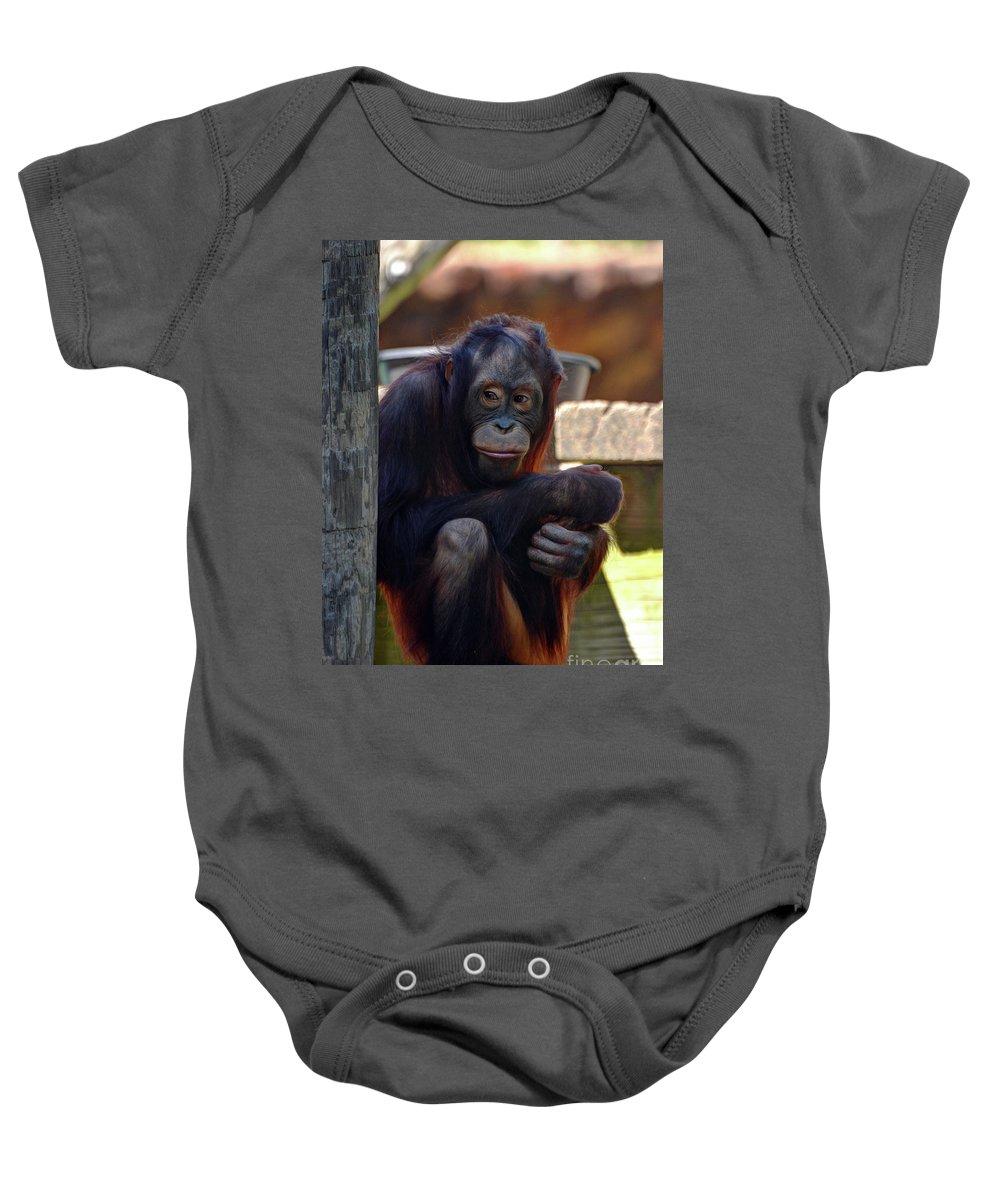 Orangutan Baby Onesie featuring the photograph The Orangutan by Savannah Gibbs