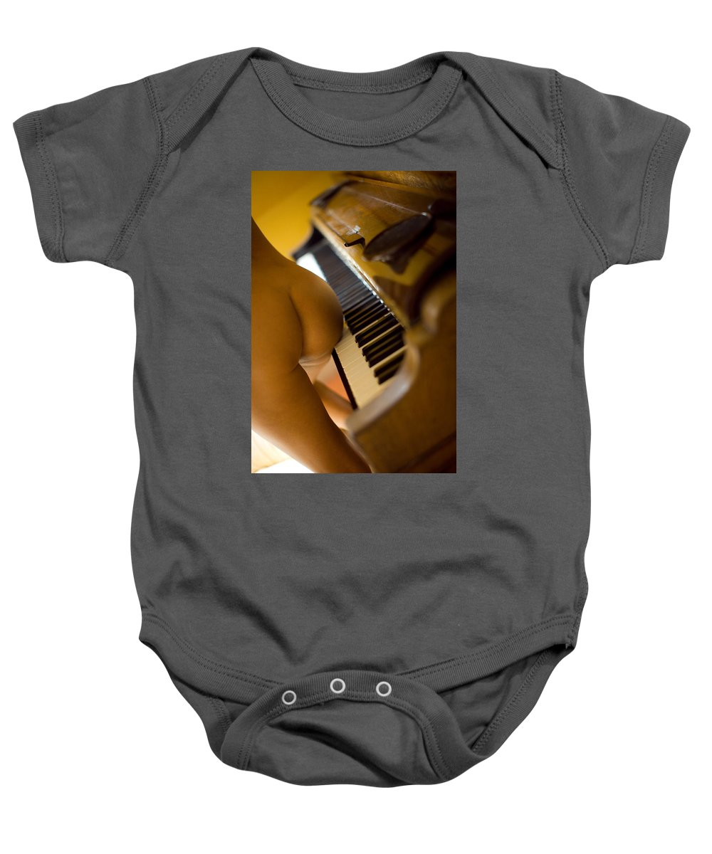Sensual Baby Onesie featuring the photograph The Piano by Olivier De Rycke