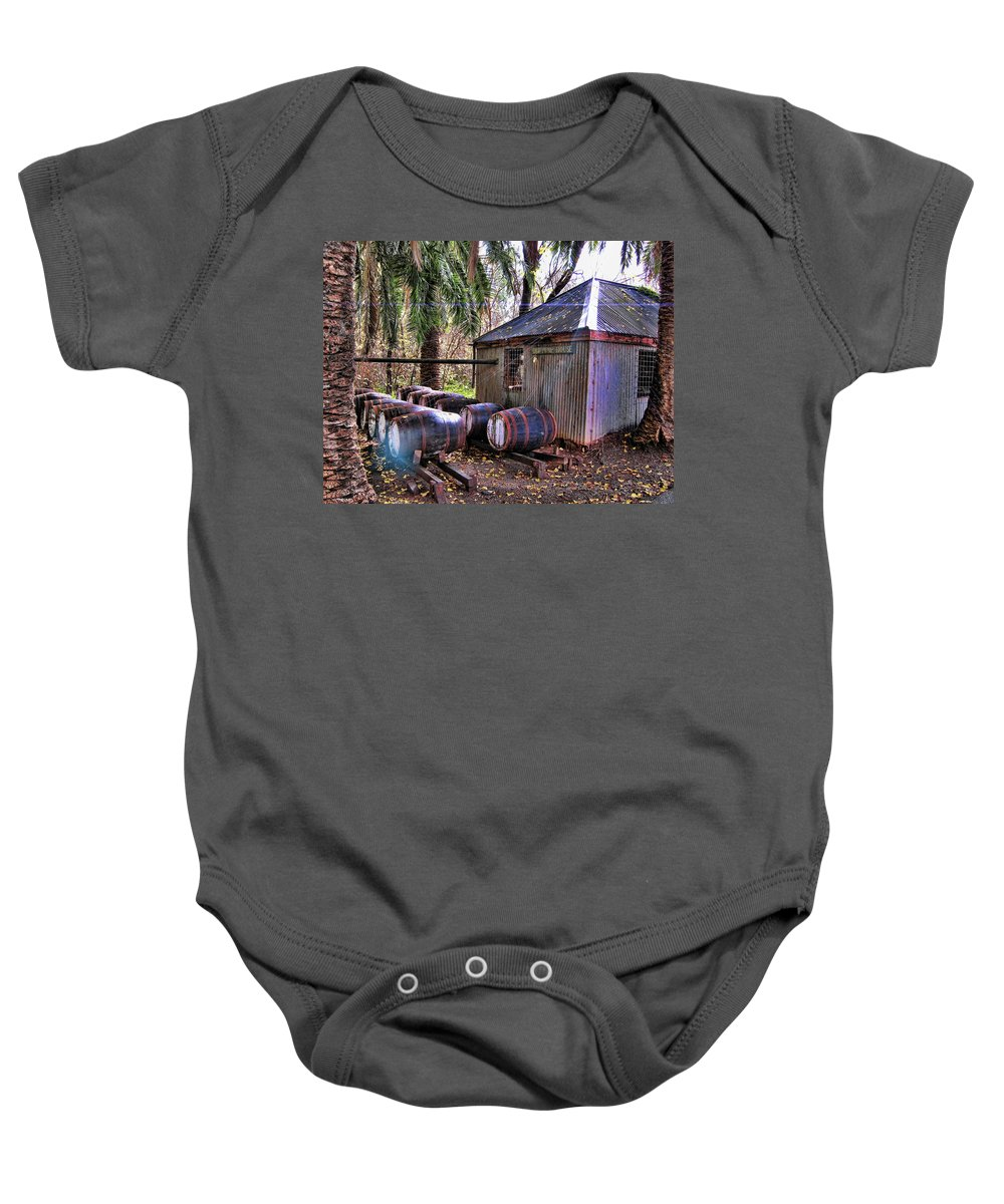 Shed Baby Onesie featuring the photograph The Pumphouse by Douglas Barnard