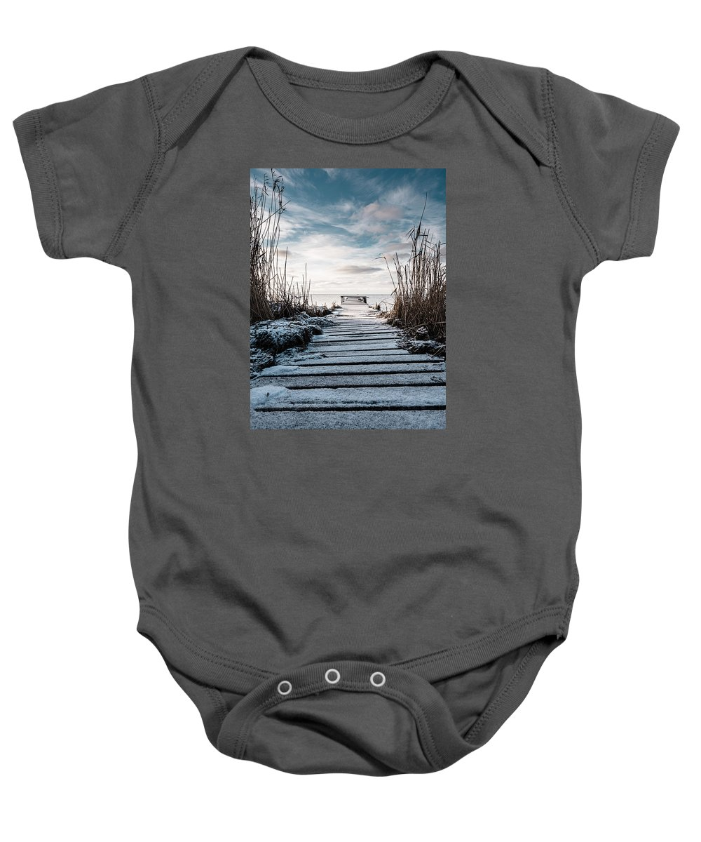 Winter Baby Onesie featuring the photograph The Rickety Jetty by Marcus Karlsson Sall