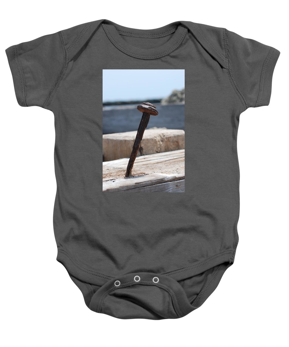 Sand Baby Onesie featuring the photograph The Rusted Spike by Rob Hans