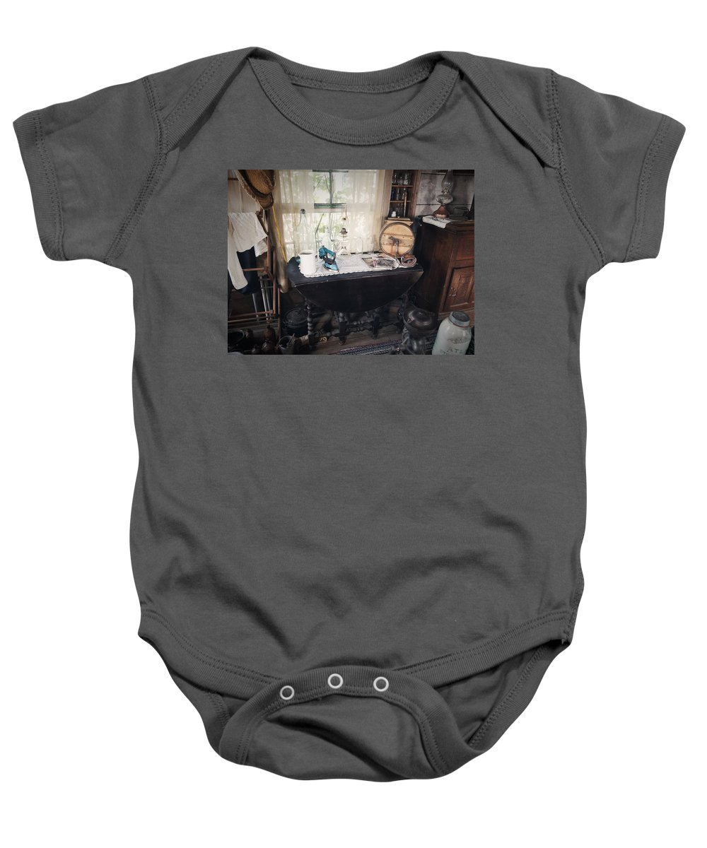 Baby Onesie featuring the photograph The Way We Once Lived by Claire Porter