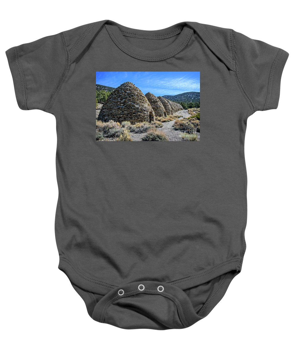 Adventure Baby Onesie featuring the photograph The Wildrose Charcoal Kilns by Charles Dobbs