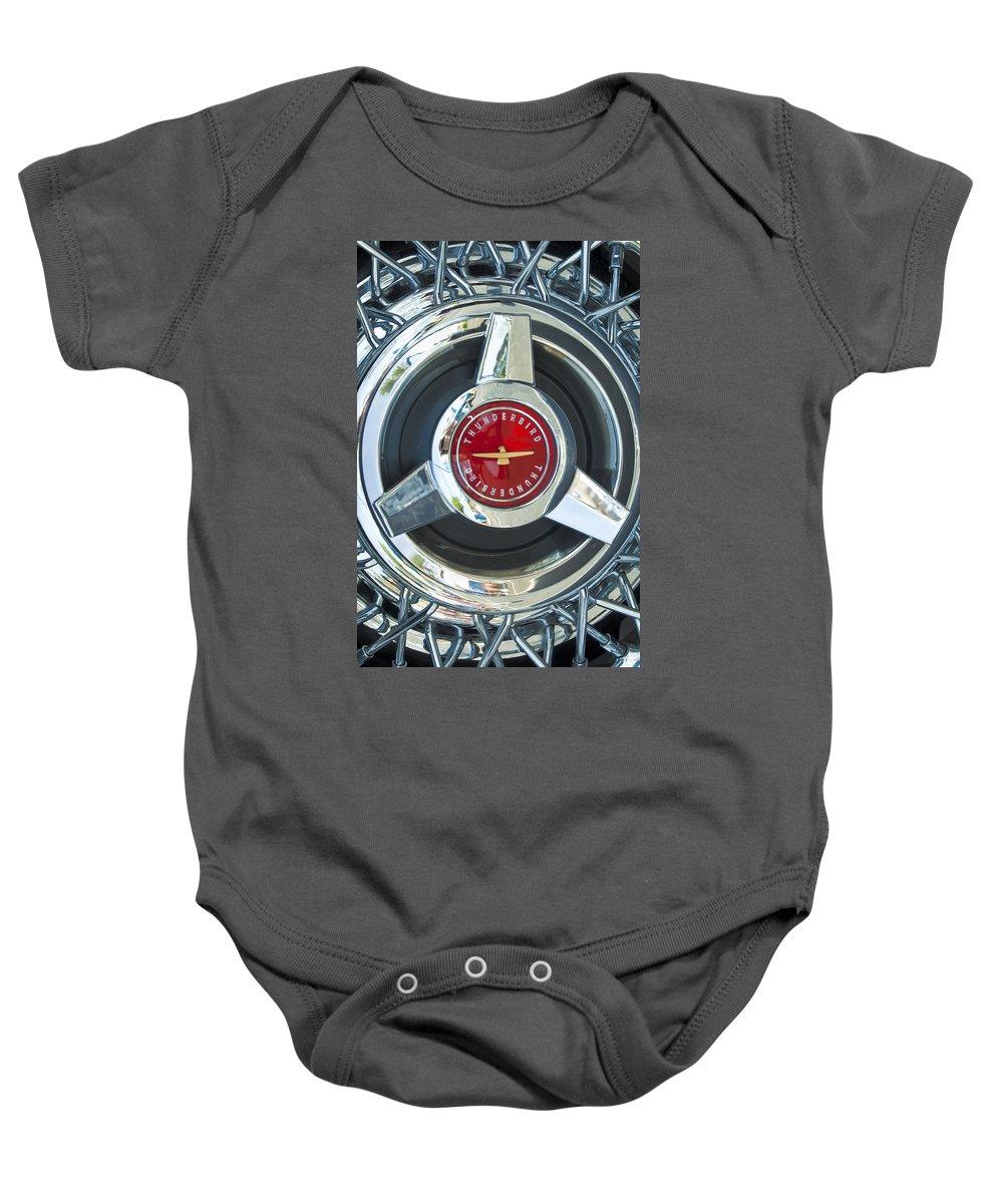 Ford Thunderbird Baby Onesie featuring the photograph Thunderbird Rim Emblem by Jill Reger