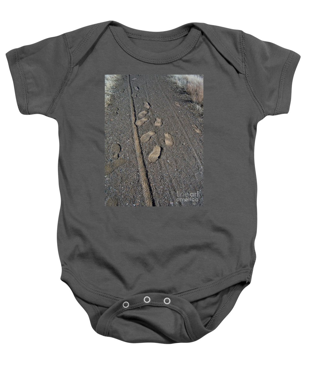 Prescott Baby Onesie featuring the photograph Tire Tracks And Foot Prints by Heather Kirk