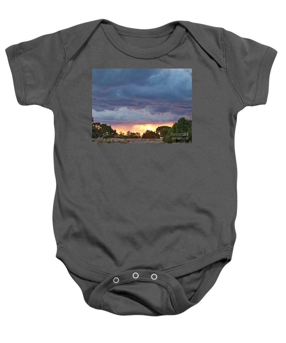Skyscape Baby Onesie featuring the photograph Touches Of Pink by Brian Commerford