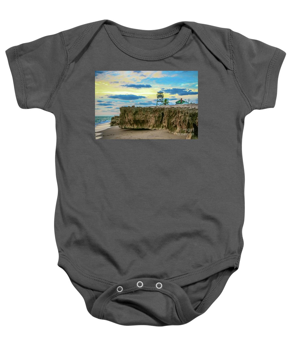 Tower Baby Onesie featuring the photograph Tower And Rocks by Tom Claud