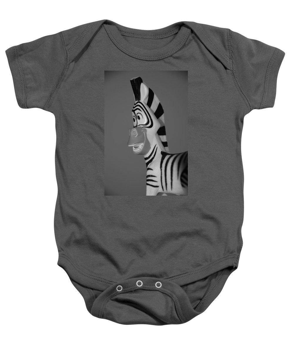 Black And White Baby Onesie featuring the photograph Toy Zebra by Rob Hans